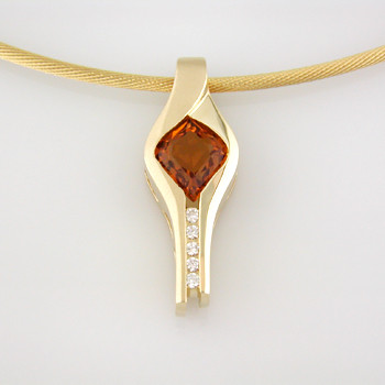 Warm and glowing, this pendant is a one-of-a-kind dazzler. 14 karat Yellow Gold surrounds this 1.55ct. custom cut onion shape Citrine, from the renowned gem cutting artists of Idar-Oberstein, Germany. Accented with .08ct. T.W. of Ideal cut Diamonds. Includes a 14 karat Yellow Gold oval link chain, 18 inches long.  Designed, and created in our studio by the artist Stuart J.