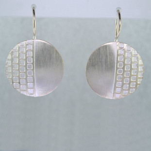 Fun for everyday, these earrings will be your go-to accessory. Modern geometric circles in Sterling Silver, dangling from wires. Measure 3/4 inch long.  Handmade in Istanbul, Turkey.