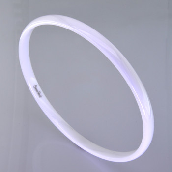 This new age bangle bracelet is made from space age Gem Ceramique ceramic, and is perfect for stacking, or distinctive on it's own. Silky smooth, and bright glossy white, it measures 1/8 inch wide.  Also comes in many other colors. Just ask us for your favorite.   Made in Camden, Maine by award winning designer Etienne Perret.