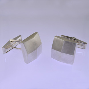 These solid Sterling Silver cufflinks look modern and sophisticated. Hand finished with a classic square shape, and light textured finish for an understated, but distinctive look. Measures 5/8 inch.  by David Heston of San Rafael, California.
