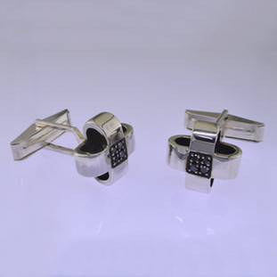 "Black diamond cuff links for the sophistcated man. Handcrafted in solid Sterling Silver, with contrasting black diamonds for a modern feel. Measures 5/8"" long and 5/8"" wide.  by David Heston of San Rafael, California."