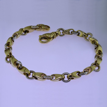 This beautiful open link two tone bracelet has an elegant, luxurious feel. Handcrafted in solid 14 karat yellow and white gold. Measures 7.5 inches long, and can be orderd in any size, or karat and color of gold, and platinum. How's that for options. This one, however, is ready for a wrist now.  Proudly crafted in the U.S.A.