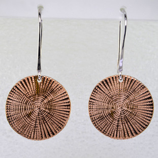 Beautiful spiral earrings in rose gold plated sterling silver. Dangling on wires, these stylish earrings measure 1 1/2 inches long.  Handmade in northern Spain