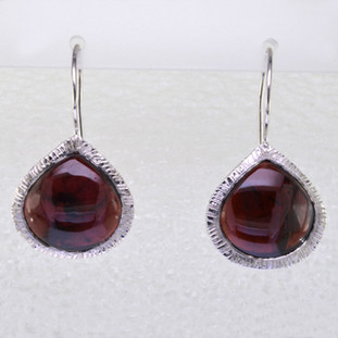Simple, sophisticated single tear drop Amethyst earrings in rhodium plated Sterling Silver, with 12x14mm deep red Garnet cabachon pear shapes, hanging on wires. Measuring 1 1/4 inches long.  Handcrafted in northern Spain.