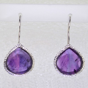 Simple, sophisticated single tear drop Amethyst earrings in rhodium plated Sterling Silver, with 12x14mm purple Amethyst cabachon pear shapes, hanging on wires. Measuring 1 1/4 inches long.  Handcrafted in northern Spain.