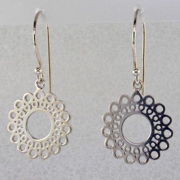 Designed, and created in our studio by the artist Stuart J., these airy earrings are fun for day or night. Handcrafted in Sterling Silver, hanging on wires. They measure 1 1/4 inches long.