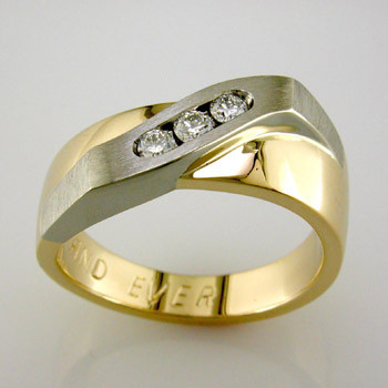 Modern and elegant man's diamond wedding ring, in 14 karat yellow gold and white gold, set with .36ct. T.W. of ideal cut diamonds.  This custom designed ring is individually crafted to be Perfectly You, and takes about 3-5 weeks to create. Call us for more information about how we can customize this design Just For You. Designed, and created in our studio by the artist Stuart J.