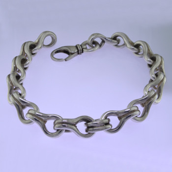 Go bold with this stylin' Sterling Silver key hole link bracelet, in a modern design. Uniquely designed for a man, it effortlessly transitions from casual to dressy. Weighs about 1 3/4 ounces, and measures about 3/8 inch wide and 8 1/2 inches long.  by David Heston of San Rafael, California.