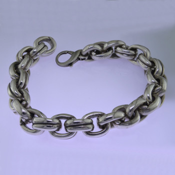 Go bold with this stylish oval link Sterling Silver bracelet, in a modern design. Uniquely designed for a man, it effortlessly transitions from casual to dressy. Weighs a hefty 3 1/2 ounces. and measures about 1/2 inch wide and 8 1/2 inches long.  by David Heston of San Rafael, California.