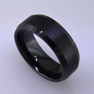 "For the innovative and unique man, this men's ring can be for many occasions. Wear it as a wedding ring, or just a stylish everyday fashion statement ring. This ring is ultra durable for the guy who plays rough. And no charge for re-sizing. This ring is black ceramic, with a flat bevel edge, a brushed finish center, and polished edges. Ring shown is 8mm wide and a size 10, but call us with your finger size and we will make it just for you. Usually within just a few days.  This ring is hypoallergenic, and environmentally friendly. Made with Gem Ceramique, this ring uses high tech zirconia ceramic, virtually as hard as sapphire. Ultra durable and stylish, versatile and unique. It even has a Lifetime ""Peace of mind"" warranty against breakage.    Created by award winning jewelry artist Etienne Perret, and made in his studio in Camden, Maine."