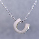What's your story? Begin with this Little lucky horseshoe solid Sterling Silver pendant. Wear it alone, with other pendants , or layered with other necklaces. Comes with a sterling silver ball chain, 16 inches long. The pendant measures 1/4 inch long. Too cute!  Signified by a feminine sensibility and optimistic charm, Alex Woo's Little Icon Collections reinvent familiar symbols from the world around us into fresh and expressive designs.  Designed and handcrafted by Alex Woo in New York City.