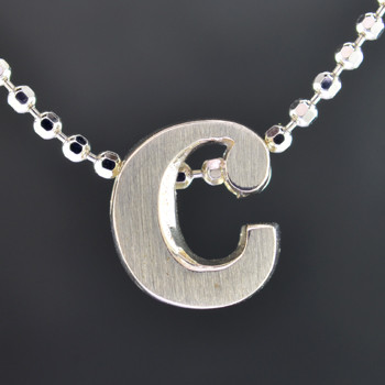 """What's your story? Begin with this Little """"C"""" initial solid Sterling Silver pendant. Wear it alone, with other pendants, or layered with other necklaces. Comes with a sterling silver ball chain, 16 inches long. The pendant measures 1/4 inch long. Too cute!  Signified by a feminine sensibility and optimistic charm, Alex Woo's Little Icon Collections reinvent familiar symbols from the world around us into fresh and expressive designs.  Designed and handcrafted by Alex Woo in New York City."""