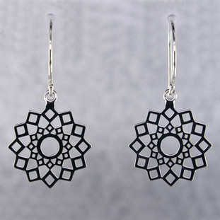 Designed, and created in our studio by the artist Stuart J., these airy earrings are fun for day or night. Handcrafted in Sterling Silver, hanging on wires. They measure 1 1/4 inches long.  More metal options are available. Please call us to find out the other options.