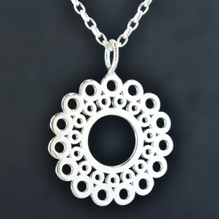 Playful and bright, this sunburst pendant is a delight to wear. Sterling Silver with a sunburst flower pattern and hangs on a 2mm Sterling Silver long link chain, 18 inches long. Pendant measures 1 1/2 inches long.  Created and handmade by master jeweler Stuart J.