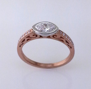 Using sophisticated techniques, this mesmerizing diamond engagement ring is designed to thrill and inspire. Hand crafted in 18 karat rose gold, and set with .07ct. total weight of brilliant cut diamonds. A stunning .45ct. marquise diamond takes center stage in this stylish engagement ring. This design blends contemporary and classical, for an understated yet sophisticated look. Shown with available matching wedding ring sold separately Here. Designed by the acclaimed artist Alishan in his California studio. All designs can be made any way you like, with any gemstones you like.