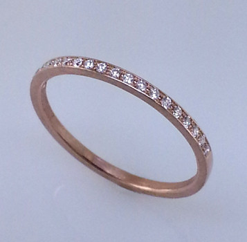 This matching diamond wedding ring to Adelina is an elegant compliment to an already classy engagement ring design.  Lined with .10ct. total weight of brilliant cut diamonds, hand set in 18 karat Rose gold. You can also wear it as a stackable ring, or as is!   Designed by the acclaimed artist Alishan in his California studio.