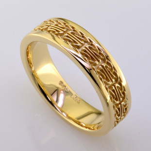 What is Irish, means faithful and loyal, and is a mans wedding band? Meet Dillon. This handsome ring is 6mm wide, is crafted in rich 14 karat yellow gold, and has an intricate celtic pattern. This wedding ring is a size 10.5, but can be made in any finger size, width, or metal you desire. Please allow 2- 3 weeks for us to make it Just For You.  Designed, and created in our studio by the artist Stuart J.