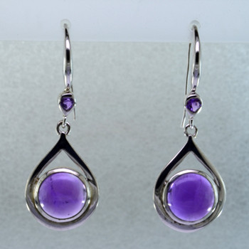 Simple, sophisticated drop dangle tear drop Amethyst earrings in rhodium plated Sterling Silver, with 10mm purple Amethyst cabachon round shapes, and on top 2- 3mm round Amethyst round cabachons hanging on wires. Measuring 1 1/4 inches long. An Exceptional Value.  Handcrafted in northern Spain.