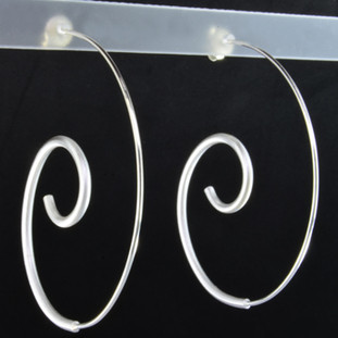 These sculptural hoops are amazing. Handmade in Istanbul, beautiful large swirl design with a soft feel, and a bold look. Light and comfortable too. Hangs on a silver post. You will definitely make a statement with these beautiful earrings. These earrings measure 2 inches long, and 1 3/4 inches wide.