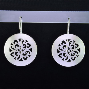These round,oriental filagree design Sterling Silver earrings will make you shine in any outfit. Wear them with your jeans or for an evening out. With Sterling Silver ear wires. Measure 1 3/16 inches.  Handmade in Istanbul, Turkey.