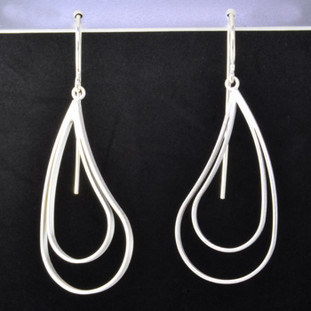 Fun open and modern sterling silver earrings with a paisley design. Hangs on sterling silver wires. Measures 2 inches long. Created in Istanbul.