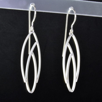 Light and breezy sterling silver modern open leaf earrings. Hangs on sterling silver wires, and measures 1 3/4 inches long. Created in Istanbul.