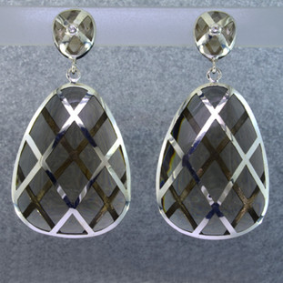Beautiful Gem grade resin long drop earrings, with an iridescent silver and grey lattice pattern flowing thru the earring. Hangs on sterling silver posts.  Elegant, sophisticated, and one of a kind. Wear for day, or evening.Measures 2 inches long. Created in studio by french jeweler Sean Hill.