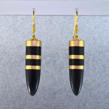 Beautiful Gem grade resin long drop bullet earrings, with a vermeil and black resin striped pattern flowing thru the earring. Hangs on sterling silver wires.  Elegant, sophisticated, and one of a kind. Wear for day, or evening.Measures 2 inches long. Created in studio by french jeweler Sean Hill.