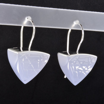 Beautiful Gem grade calcedony resin drop earrings, with a sterling silver and triangle shaped pattern running thru the top.. Hangs on sterling silver wires.  Elegant, sophisticated, and one of a kind. Wear for day, or evening.Measures 1 1/4 inches long. Created in studio by french jeweler Sean Hill.