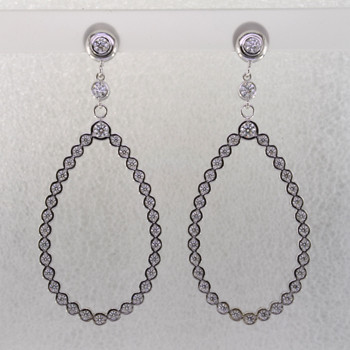 These jaw-dropping and elegant dangle diamond earrings will make you the envy of everyone that sees them. Crafted in 14 karat white gold, with 2.36 carats of sparkling ideal cut diamonds. Set in bezels so they feel soft and smooth, you will feel like a queen with these on your ears! Hangs on posts, and measures 2 1/4 inches long.  Made in our studio by the artist Stuart J.  These earrings can be customized to be Perfectly You, ans made in any karat or color of gold, and in platinum.