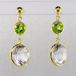 Elegant, sophisticated, 18 karat yellow gold drop earrings with thin bezels holding them in just enough to let the stones shine. 21.95ct. of round shaped peridot and rock crystal gemstones, hanging on posts. Measure 1 1/2 inches long.  Handmade in Brazil.