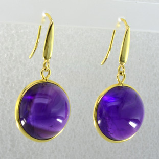 Elegant, sophisticated, 18 karat yellow gold drop earrings with thin bezels holding them in just enough to let the stones shine. 32.0ct. of round shaped cabachon amethyst hanging on wires. Measure 1 1/4 inches long.  Handmade in Brazil.