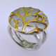 Gold branches stand out against a wintry white background in this nature inspired Sterling Silver ring. The ring measures 1 inch around, for a distinctive look. Finger size 6 1/4. An Exceptional Value. Handcrafted in Northern Spain.