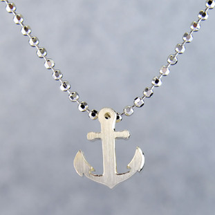 What's your story? Begin with this Little Anchor, solid Sterling Silver pendant. Wear it alone, with other pendants, or layered with other necklaces. Comes with a sterling silver ball chain, 16 inches long. The pendant measures 1/4 inch long. Too cute!  Signified by a feminine sensibility and optimistic charm, Alex Woo's Little Icon Collections reinvent familiar symbols from the world around us into fresh and expressive designs.  Designed and handcrafted by Alex Woo in New York City.