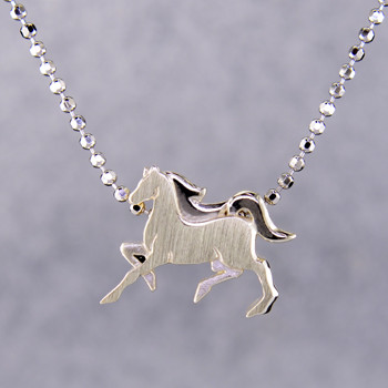 What's your story? Begin with this Little Horse, solid Sterling Silver pendant. Wear it alone, with other pendants, or layered with other necklaces. Comes with a sterling silver ball chain, 16 inches long. The pendant measures 1/4 inch long. Too cute!  Signified by a feminine sensibility and optimistic charm, Alex Woo's Little Icon Collections reinvent familiar symbols from the world around us into fresh and expressive designs.  Designed and handcrafted by Alex Woo in New York City.