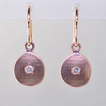 These sweet earrings shimmer when you wear them. Beautiful in 14 Karat rose gold, these medallions with sparkly diamonds weighing .06ct. in the center, hanging from 14 karat rose gold wires.  Earrings measure 3/4 inch long. Available in other colors. Please call for pricing.  Designed and created in our studio by the artist Stuart J.