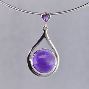 "Simple, sophisticated drop dangle tear drop Amethyst pendant in rhodium plated Sterling Silver, with 12mm purple Amethyst cabachon round shape, and on top 1- 3mm round Amethyst round cabachon hanging on a 1.5mm round sterling silver omega wire, 16"". Measuring 1 1/4 inches long. An Exceptional Value.  Handcrafted in northern Spain."