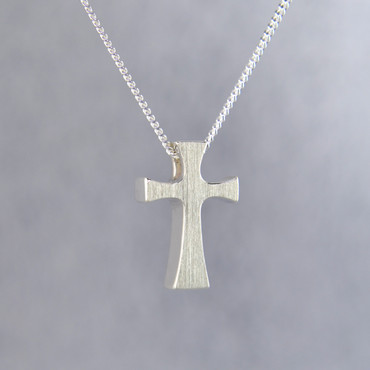 "Feel your devotion in divine style with this chunky modern sterling silver cross pendant, perfect for any age. Hanging on a sterling silver curb chain, 18"" long, our cross pendant measures 3/4 inches tall by 3/8 inches wide.  Designed and created in our studio by the artist Stuart J."