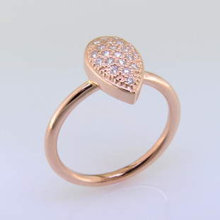 Sweet and enchanting, this beautiful 14 karat rose gold diamond ring is set with 0.16 carat T.W. of sparkly ideal cut diamonds. This eye pleasing pear shape design can be worn alone, or stacked with your favorite rings. Easily sized, or we will custom make it in your finger size.  Designed, and created in our studio by the artist Stuart J.