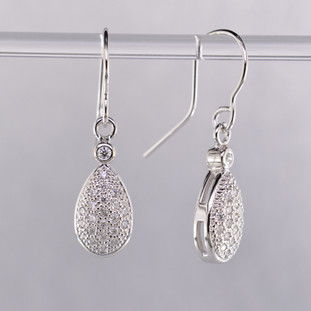 Timeless and elegant, these diamond earrings will dazzle! Perfect diamond earrings to wear anywhere, anytime. Sparkling ideal cut diamonds, set in 14 karat white gold, total just over a third of a carat (0.34 carat T.W.). These beautiful diamond earrings measure a 1/2 inch long and dangle from hand-made wires.  Designed, and created in our studio by the artist Stuart J.