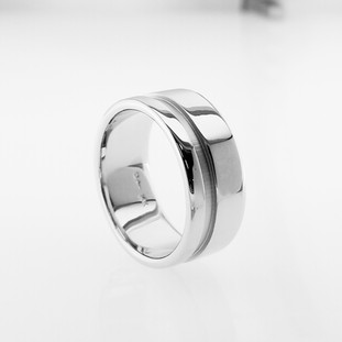 It is amazing to feel a nice hearty ring on your finger, and that it will last forever! This is the philosophy we have for making jewelry. Created in 14 Karat white gold, 10mm wide, and a flat beveled edge gives this ring style. We make a ring that will be passed down from generation to generation. That makes us happy!   Designed, and created in our studio by the artist Stuart J.
