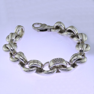 Go bold with this classic Sterling Silver and Diamond bracelet, in a modern design. Uniquely designed for men or women, it effortlessly transitions from day to night. Contains .40ct. T.W. of Diamonds and weighs about 3 1/2 ounces in total. About 3/8 inch wide and 7 3/4 inches long.  by David Heston of San Rafael, California.