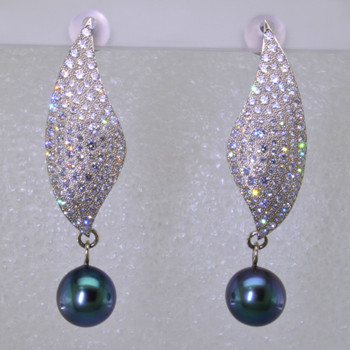 Sparkly, elegant, and sensual only begin to describe these Diamond and Tahitian Pearl earrings. Handrafted in 14 karat White Gold with over 3cts. of fine Ideal cut Diamonds and 2 perfectly matched, super fine, 9.5mm cultured Tahitian Peacock colored Pearls. Need we say more? Earrings measure 1 ¾ inches long, and hang on posts.   Designed and handmade by the artist Stuart J.