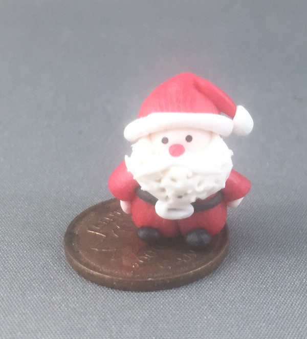 Handcrafted Tiny Santa