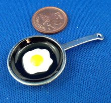 Black Frying Pan with Egg