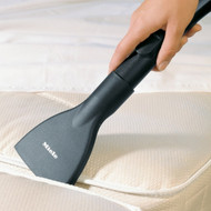 This wide, flat nozzle lets you reach between mattresses and bed frames to clean every last bit of dust and debris.