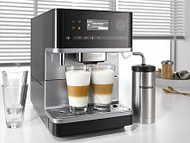 """Miele CM6310 - Black: For more enjoyment together:  All bean-to-cup coffee machines are equipped with the new OneTouch for Two function as well as with the already familiar OneTouch feature. This function allows you to make two delicious coffee specialities at the same time by simply touching a button. The program starts automatically. """"Because preparation takes less time, you have more time together."""""""
