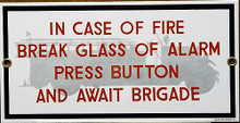 Photo of FIRE BRIGADE PORCELAIN SIGN,  IN CASE OF FIRE BREAK ALARM GLASS, PUSH BUTTON AND AWAIT FIRE BRIGADE SIGN HAS SHARP COLORS AND DETAIL THIS SIGN IS OUT OF PRINT, WE HAVE ONLY ONE LEFT
