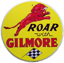 GILMORE GAS SIGN  ROAR WITH GILMORE HAS A LEAPING LION, BRIGHT COLORS NICE GRAPHICS