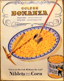 GOLDEN BONANZA CORN SIGN HAS A BOWL OF CORN WITH A GOLDEN SHOVEL & PICK.. ALSO A CAN OF CORN WITH THE GREEN GIANT ON IT, OLD FASHION COLOR AND DETAIL